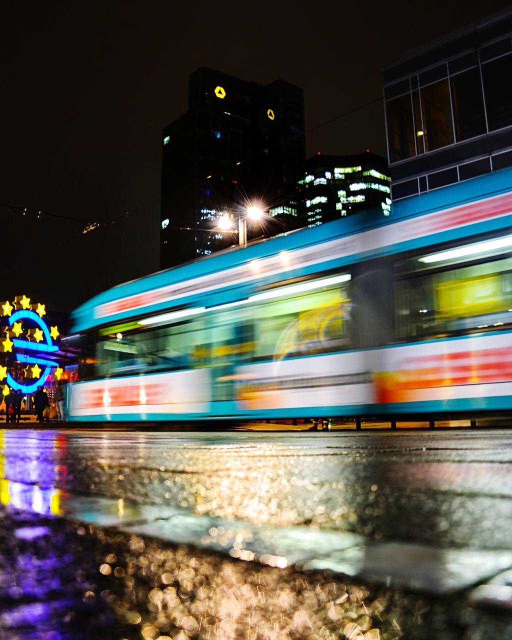 BLURRED MOTION OF CITY STREET AT NIGHT
