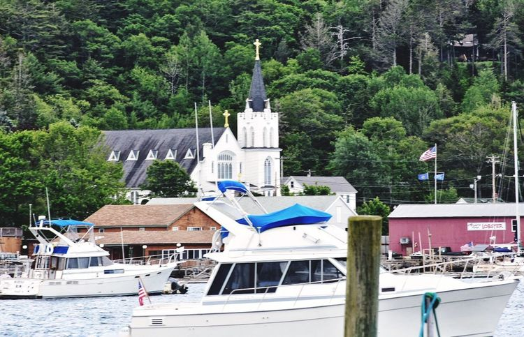 Harbor Nautical Vessel Outdoors Flag Tree Day Travel Destinations Built Structure Architecture Vacations Building Exterior Sky Maine Boothbay Harbor Maine Church Steeple Catholic Church Our Lady Quieen Of Peace Mainethewaylifeshouldbe