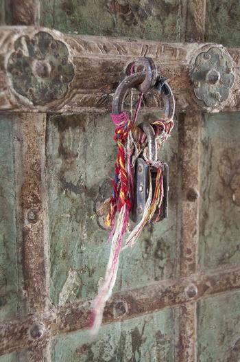 Close-up of padlocks hanging on wall