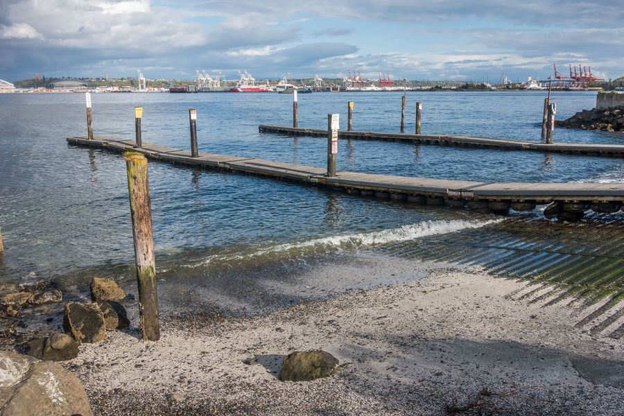 West Seattle docks with port in the distance. Pacific Northwest  Port Of Seattle Washington State West Seattle Beach Beauty In Nature Cloud - Sky Day Jetty Moored Nature Nautical Vessel No People Outdoors Pier Scenics Sea Sky Water Wooden Post