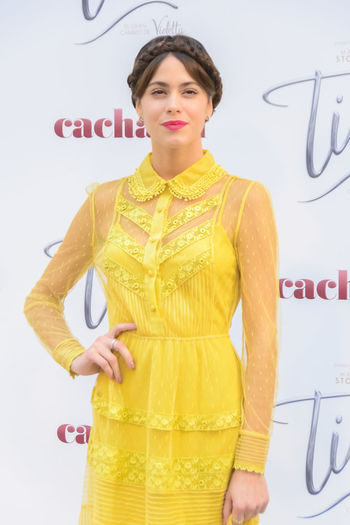 "Tini at the premiere of ""Tini: El gran cambio de Violetta"" in Madrid, Spain Actress Artistic Celebrity Close-up Editorial  Entertainment Front View Leisure Activity People Photocall Portrait Posing Singer  Tini Vip Yellow Yellow Dress Young"