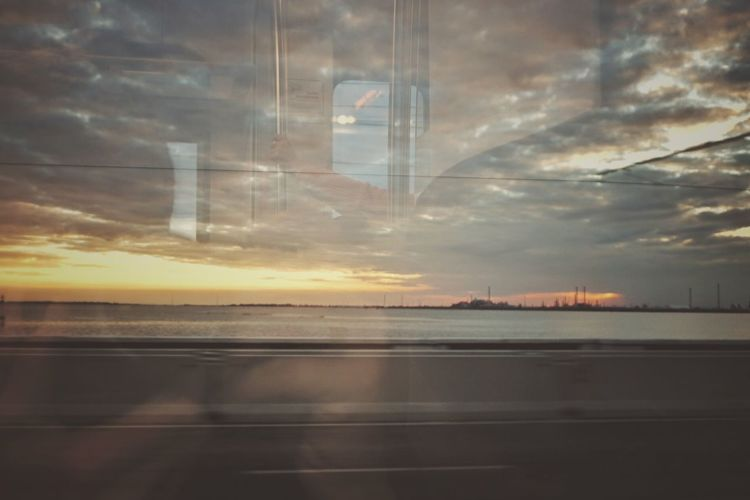 Sunset from the train window | Reflection Transportation Cloud - Sky Sunset Outdoors My Hands Still Life Personal Perspective Abstract Traveling Home For The Holidays Fine Art Window Silhouette Marghera Venezia EyeEm Italy |