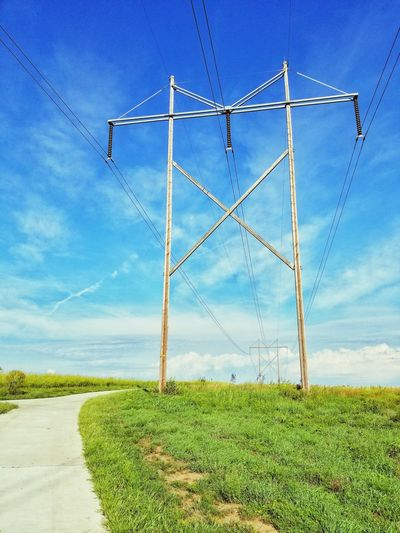 High Voltage High Voltage Line Samsung Galaxy S8 Clouds And Sky Telephone Line Electricity  Cable Blue Agriculture Fuel And Power Generation Sky Grass Power Line  Power Supply Electrical Grid Electricity Tower Electricity Pylon Electric Pole