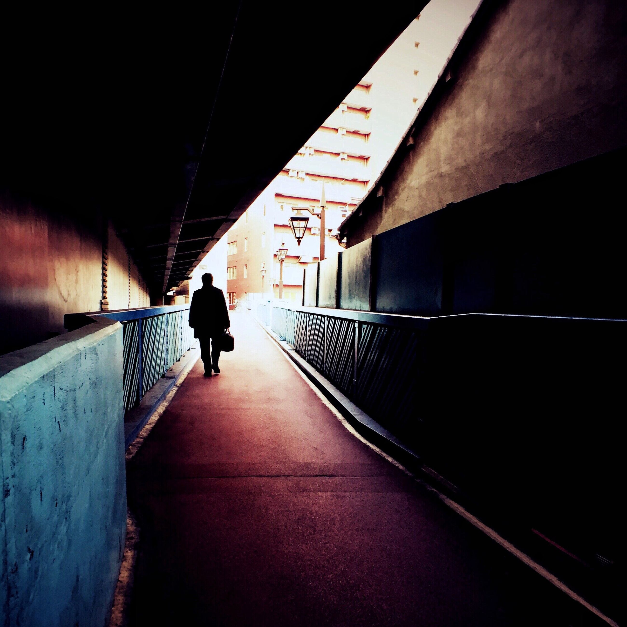 walking, full length, rear view, the way forward, men, lifestyles, architecture, built structure, silhouette, person, diminishing perspective, leisure activity, building exterior, indoors, wall - building feature, unrecognizable person, vanishing point