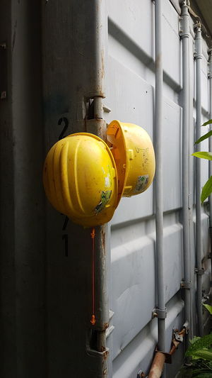 Yellow No People Built Structure Outdoors Safety Helmets HardHats Container Shipping Containers Resting Time Two Two Helmets Labor White Background Light And Shadow Paint The Town Yellow Industrial Constriction Site Manual Worker Behind The Scenes EyeEm Ready