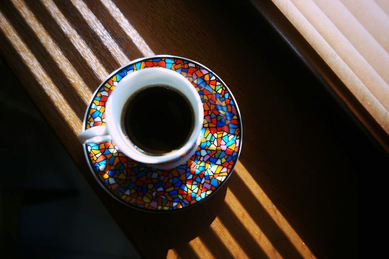 Close-up of fresh turkish coffee in pot on window sill
