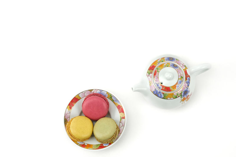 High angle view of candies against white background