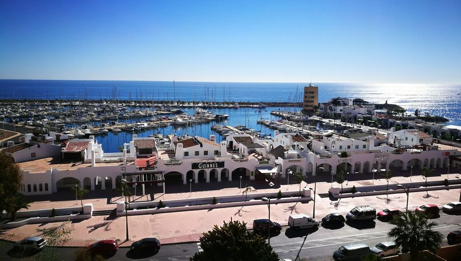 Sea Horizon Over Water Clear Sky Water High Angle View Cityscape Building Exterior Travel Destinations Architecture Beach Vacations No People Outdoors Almería Spain Best Weather🙌🏻 Almeria Summertime Sunlight Almeriaturismo Tranquility ParentsAreMoving Landscape Paseo Built Structure
