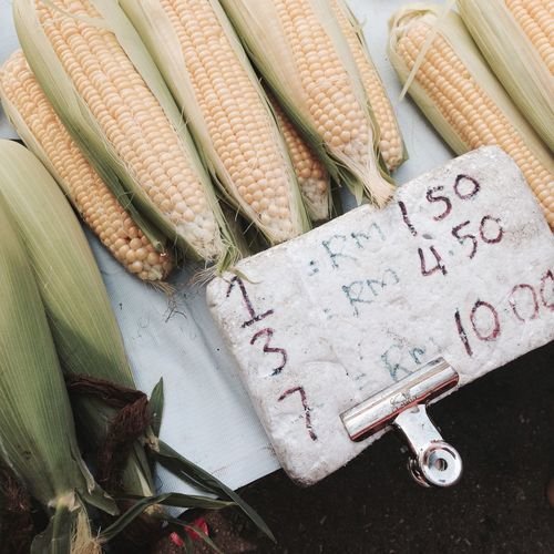 High Angle View Of Sweetcorn For Sale At Market Stall