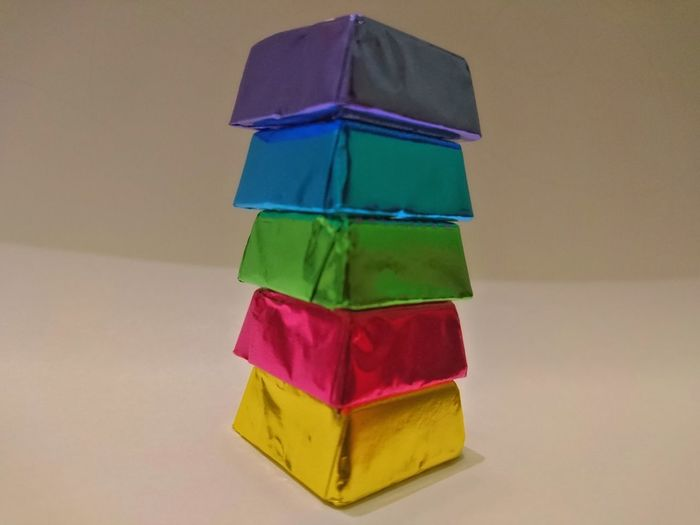 Stack Multi Colored Green Color Studio Shot Abundance Gift Celebration Birthday Present Variation No People Indoors  Close-up Colored Quadrate Art Is Everywhere