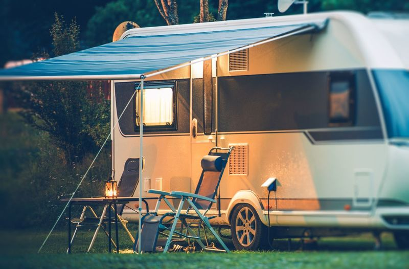 Travel Trailer Caravaning. RV Park Camping at Night. Camping Norway Rving Absence Camper Camping Day Land Vehicle Mode Of Transportation Motor Home Motor Vehicle Nature No People Norwegian Outdoors Plant Public Transportation Seat Stationary Sunlight Table Transportation Travel Travel Trailer Tree