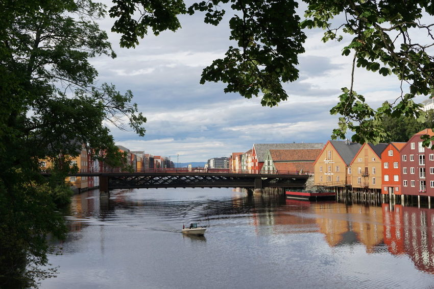 Architecture Boat Bridge - Man Made Structure Built Structure Business Finance And Industry City Cloud - Sky Colors Day Harbor No People Old Bridge Outdoors Reflection River Sightseeing Sky Travel Tree Trondheim Trondheimsfjorden Vacations Warehouse Water Waterfront