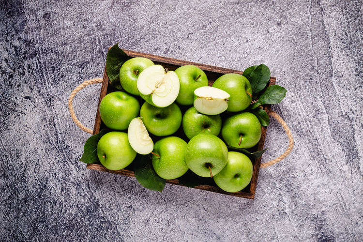 High angle view of apples on green table
