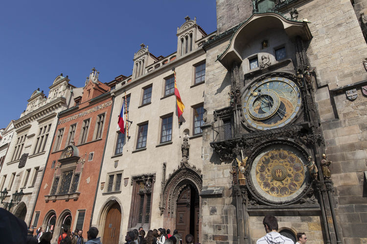 Low angle view of town hall with astronomic clock