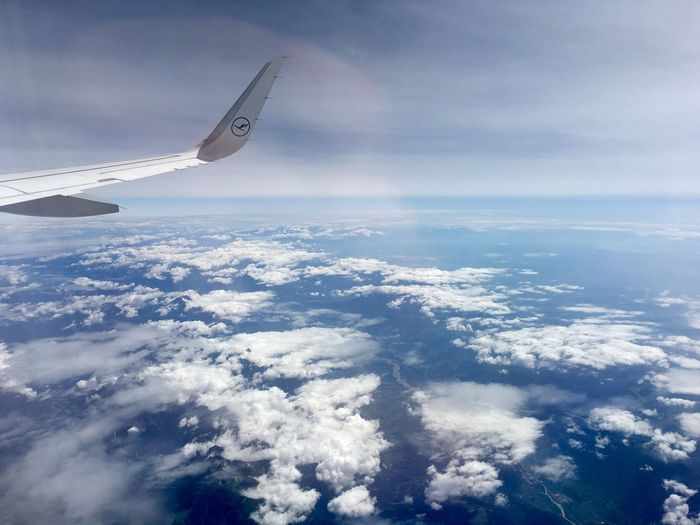 Aerial View Airplane Cloud - Sky Sky Transportation Airplane Wing Flying Journey Nature Scenics Travel Cloudscape Mid-air Sea Beauty In Nature Air Vehicle Mode Of Transport No People Aircraft Wing Blue