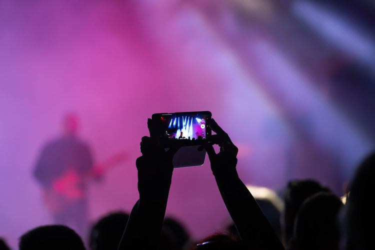 Man photographing at music concert