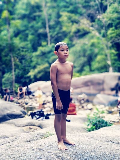 Looking for best spot for a dip at Telaga Tujuh Waterfall , Langkawi Real People Travel Travel Destinations Nature Whitewater Waterfall Child Males  Childhood Full Length Boys Standing Shirtless Summer Swimming Trunks Hiker Swimwear One Piece Swimsuit Wet Hair