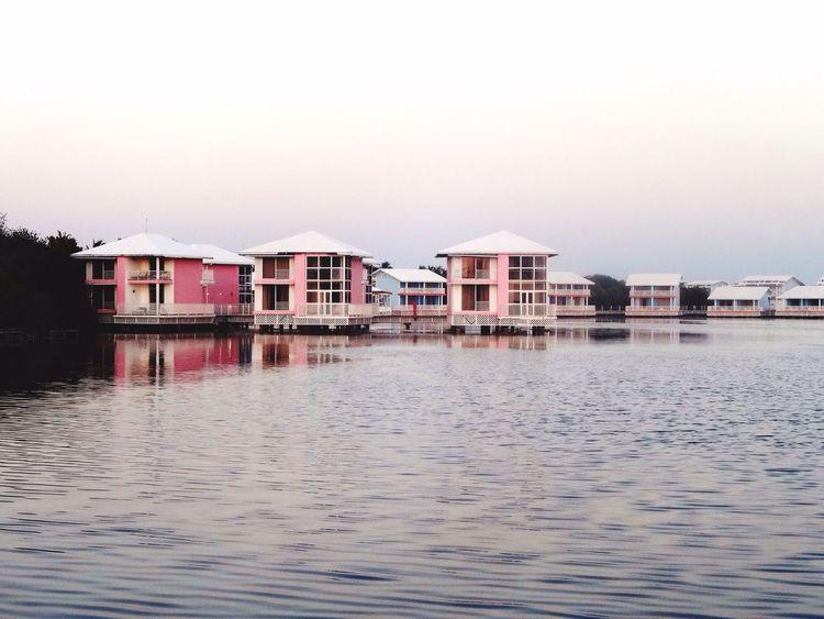 Pink Cabins  Buildings Pink Lagoon Sea Calm Dwellings