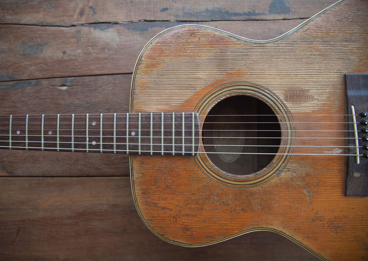 Acoustic Guitar Arts Culture And Entertainment Brown Close-up Day Design Double Bass Fretboard Guitar Music Musical Equipment Musical Instrument Musical Instrument String No People Pattern String String Instrument Wall - Building Feature Wind Instrument Wood - Material Woodwind Instrument