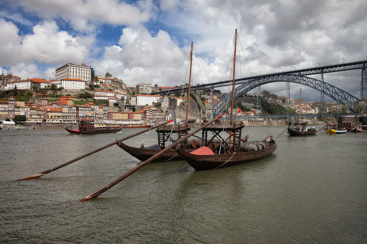 Rabelo traditional boats on Douro river, Dom Luis I Bridge, city of Porto, Portugal. Cityscape Dom Luís I Bridge Douro  Old Town Oporto Porto Portugal Skyline Travel Architecture Boats Bridge - Man Made Structure Building Exterior Built Structure City Europe Mode Of Transport Nautical Vessel No People Rabelo Rabelo Boat River Transportation Travel Destinations Water