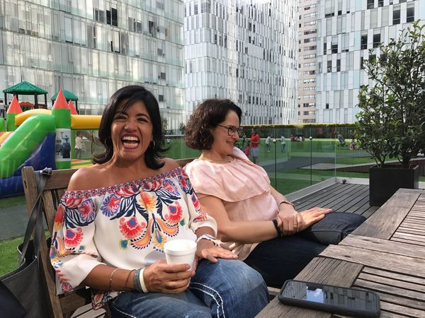 EyeEm Selects Sitting Two People Smiling Adults Only Laughing Togetherness Women Only Women Adult Coffee Break Cheerful Day People Talking City Life Enjoyment Building Exterior Happiness Friendship #urbanana: The Urban Playground