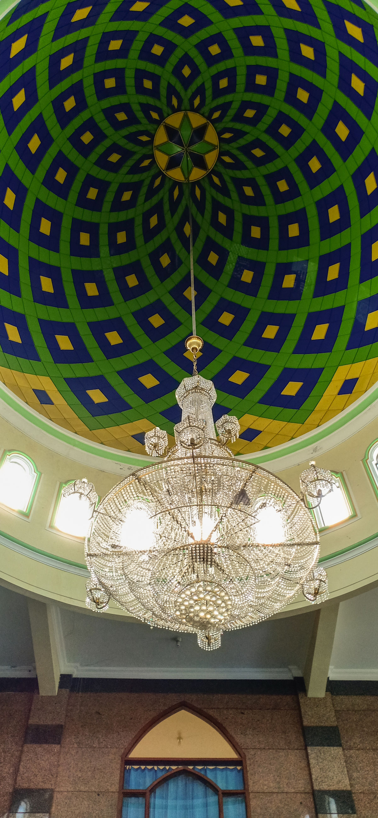 ceiling, illuminated, lighting equipment, chandelier, low angle view, indoors, hanging, pattern, decoration, architecture, built structure, no people, light, wealth, glowing, luxury, design, pendant light, electric light, ornate, electric lamp, electricity, light fixture, cupola