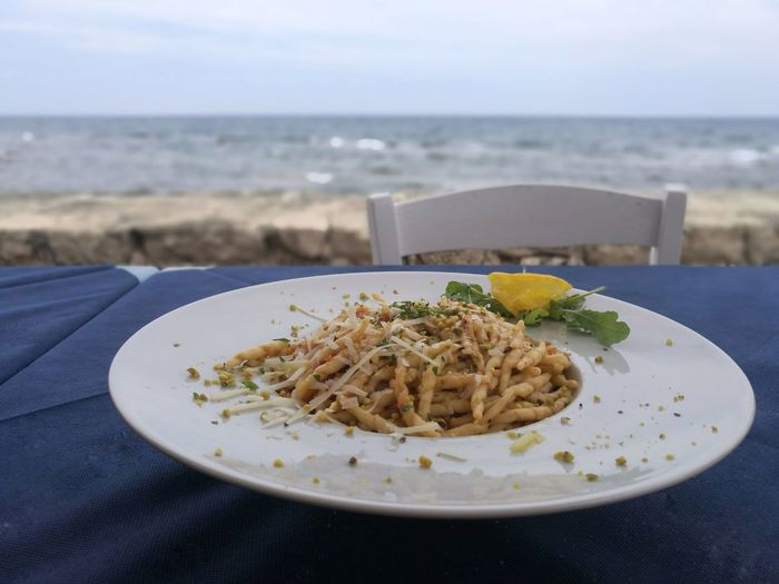 Close-up of food served on table at beach