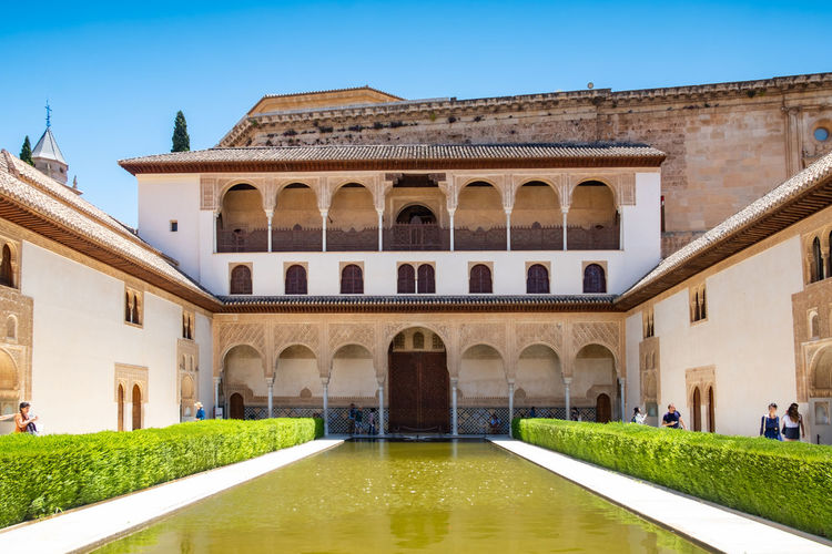 Alhambra (Granada) Alhambra De Granada  Granada, Spain The Week on EyeEm Alhambra Arch Arched Architecture Building Exterior Clear Sky Courtyard  Day Façade History Incidental People Luxury Nature Outdoors Plant Sky The Past Tourism Travel Travel Destinations Water