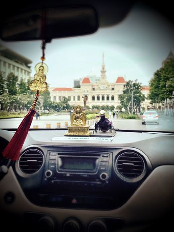 Driving with Buddha🙏🏻 Car Transportation Mode Of Transport Land Vehicle Car Interior Vehicle Interior Travel Real People City Architecture Building Exterior Sky Men Dashboard Day Outdoors Buddha Uber IPhone 7 Ho Chi Minh City Vietnam Early Sunday Morning IPhoneography City Hall