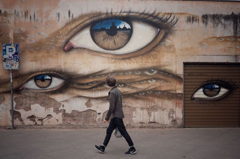 Eyes on you Paranoia Watched Urban Surveillance Watching Big Brother EyeEm Best Shots Fuji Streetstyle Streetphotography Wall - Building Feature Full Length One Person Architecture Real People Lifestyles Built Structure Creativity Graffiti Casual Clothing Young Adult Adventures In The City