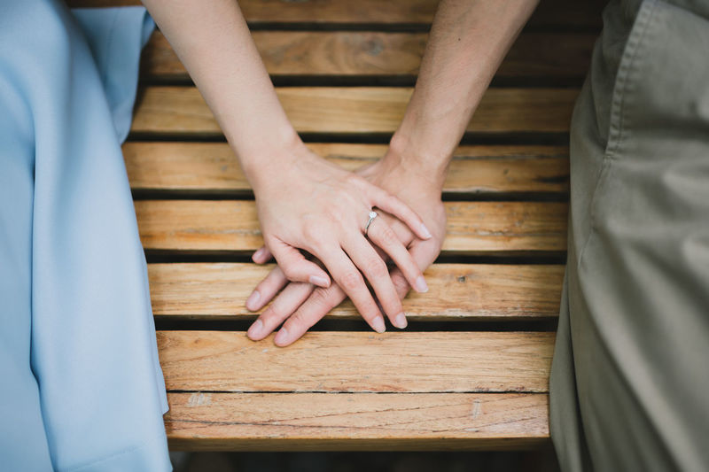Hand Human Hand Wood - Material Human Body Part Men Real People Togetherness Two People Bonding Midsection Indoors  Adult High Angle View Couple - Relationship People Lifestyles Women Table Leisure Activity Finger Love Valentine's Day  Cute Couples Ring Wedding Ring Preweddingphoto