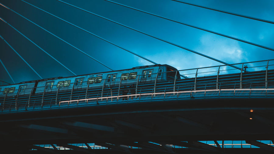 Low angle view of train on bridge against sky