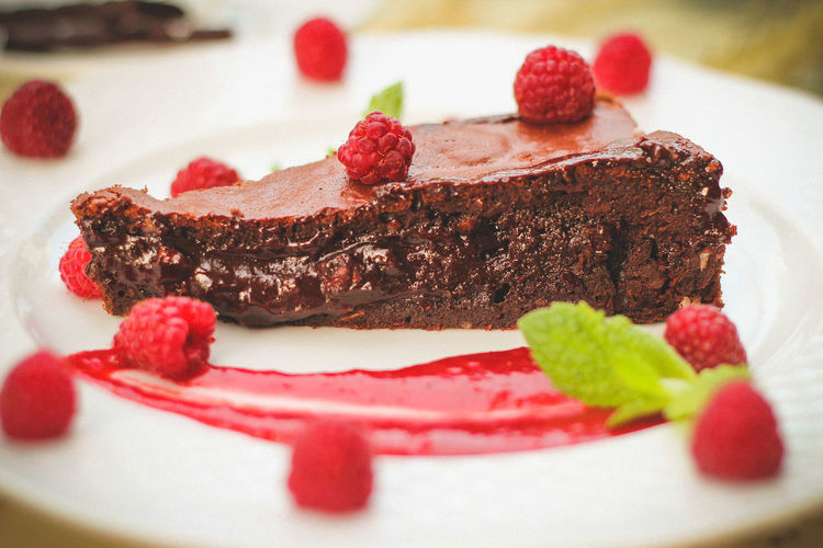 Chocolate brownie with raspberries Blueberry Brownie Cake Chocolate Cake Dessert Dessert Topping Food Food And Drink Food Styling Freshness Fruit Gourmet Indoors  Indulgence No People Plate Raspberries Raspberry Ready-to-eat Selective Focus SLICE Strawberry Sweet Food Temptation Unhealthy Eating