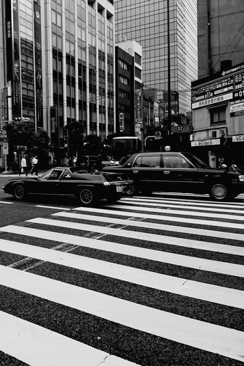 Striped City Architecture City Street Street City Life Building Exterior Built Structure Outdoors Day No People Blackandwhitephoto Blackandwhitepics Blackandwhiteonly Blackandwhite Blackandwhitephotos Monochrome World Blackandwhite Photography Car Cityscape Cars Architecture Low Angle View