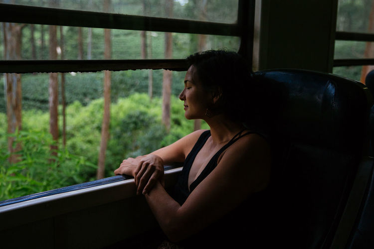 The Traveler - 2018 EyeEm Awards Tranquility Contemplation Indoors  Lifestyles Looking Through Window One Person Side View Train Ride Window Young Adult Young Women