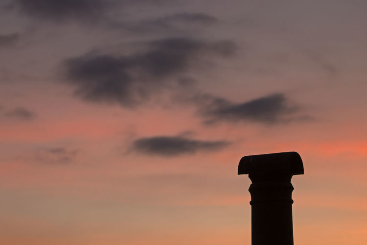 Low angle view of silhouette built structure against sky during sunset