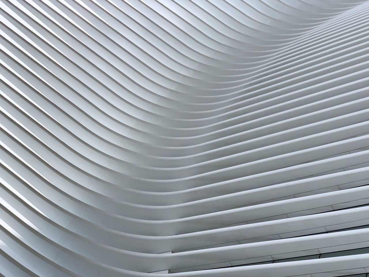 pattern, backgrounds, full frame, metal, silver colored, no people, close-up, indoors, modern, textured, architecture, ceiling, repetition, white color, abstract, gray, in a row, curve, built structure, day, steel, alloy