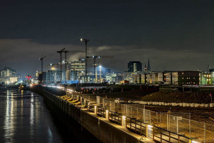 Construction Site Baakenhafenquartier Hafencity Hamburg Long Exposure Cranes Skyline Fences Architecture Building Exterior Night Sky Built Structure Illuminated Transportation Industry Nature City Water No People Factory Outdoors Motion Mode Of Transportation Waterfront Cloud - Sky River