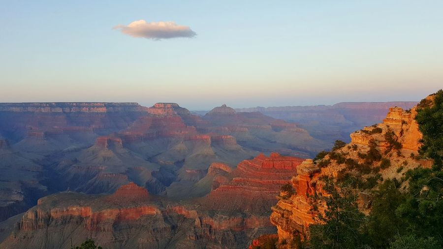 Sunset Yaki Point facing east. Grand Canyon Arizona American Southwest Landscape Small Cloud Sky Dusk Evening Canyon Vast