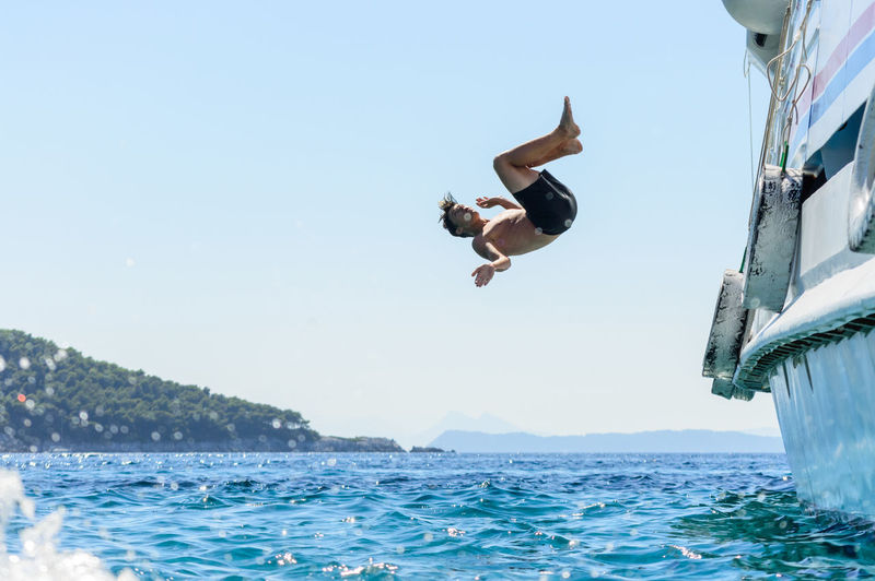 jumping from ship Done That. Clear Sky Day Energetic Full Length Jumping Mid-air Nature One Person Outdoors People Real People Sea Sky Swimming Swimming Pool Water Young Adult Travel