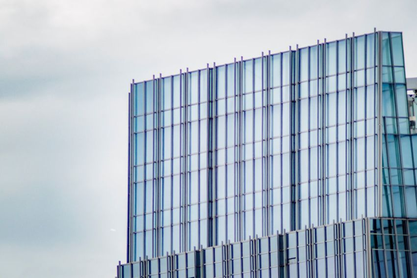 Tall glass building on a cloudy day City Architecture Building And Sky Glass And Steel Architecture Pattern Architectural Design Patterns And Textures High In The Sky EyeEm Selects Sky Building Exterior Architecture Built Structure Modern Day Glass - Material Low Angle View Office Building Exterior Reflection Pattern Blue