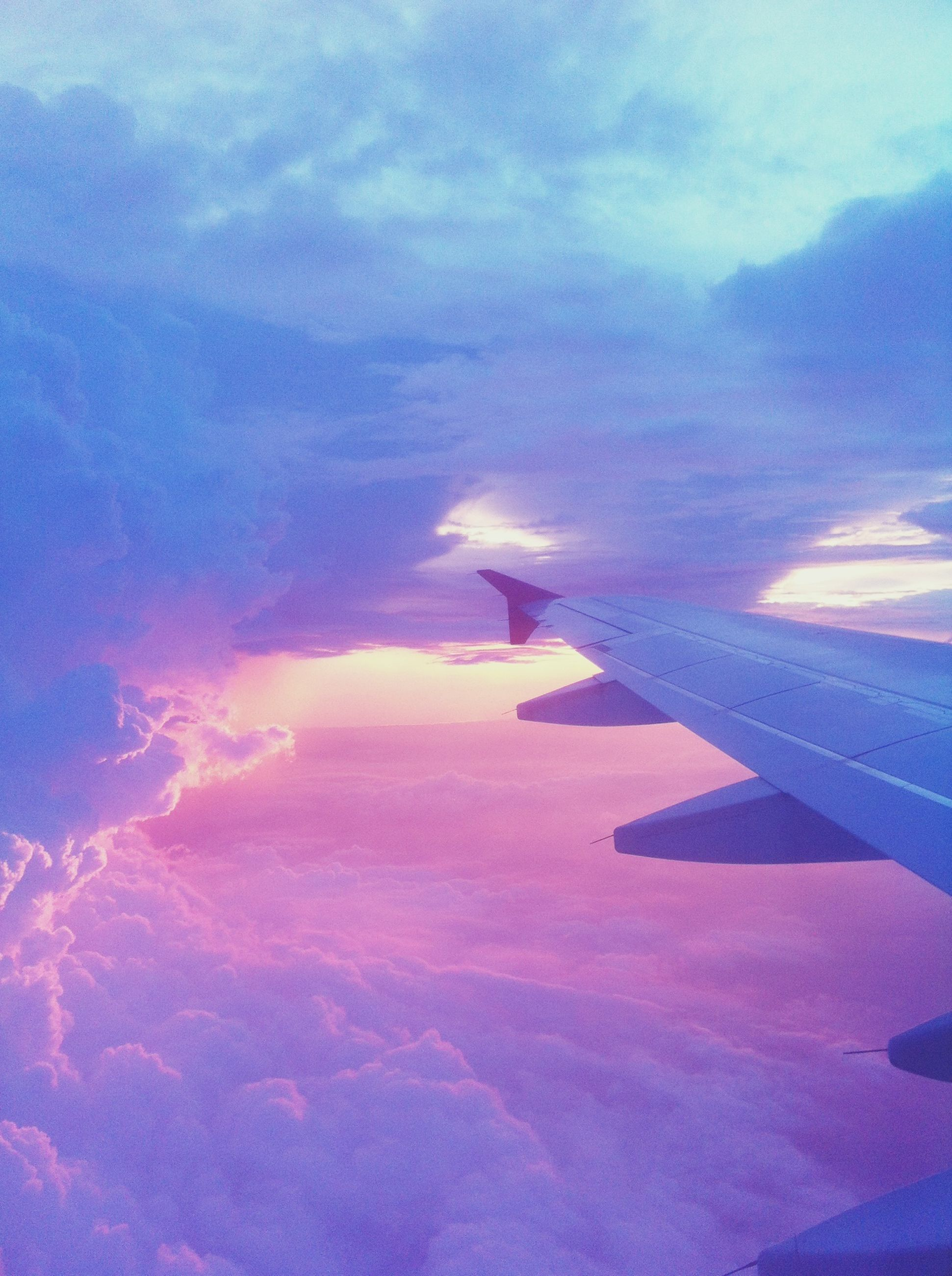 airplane, transportation, air vehicle, aircraft wing, sky, flying, mode of transport, cloud - sky, mid-air, blue, travel, part of, on the move, cloud, cropped, aerial view, scenics, journey, beauty in nature, nature