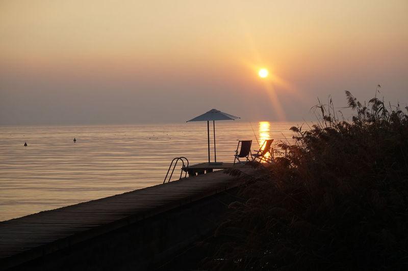 Lago Di Garda Beauty In Nature Horizon Over Water Nature Outdoors Sky Sun Sunlight Sunset Water