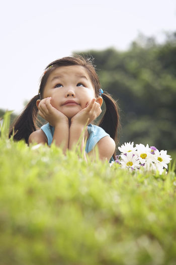 girl with flowers at meadow Grass Happiness Innocence Nature Sunny Young Cheerful Child Childhood Close-up Cute Day Elementary Age Flower Freshness Girl Headshot Lifestyles Meadow One Person Outdoors Real People Selective Focus Smiling Summer