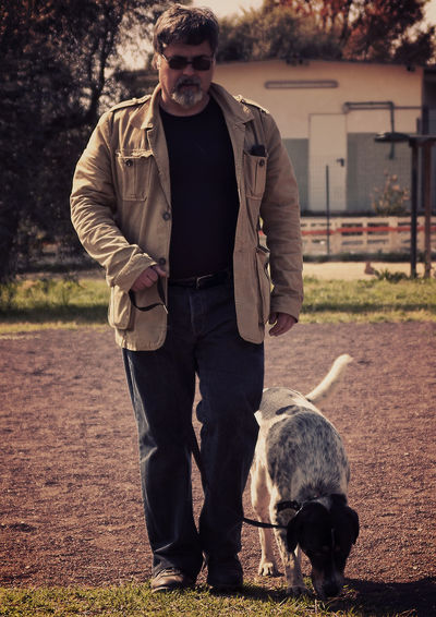 Dog Training Animal Themes Beautiful Dog Beautiful ♥ Casual Clothing Dog Dog Training Dog Training Field Dog Walking Dogs Dogslife Front View Full Length Leisure Activity Lifestyles Man And Dog Man And Dog At Work One Animal Person Standing Togetherness Trainig Training Time Young Men
