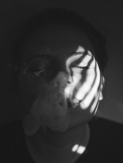 Artsy Dark Light Portrait Of A Woman Romantic Shadows & Lights Smoke Smoking Woman Adult Black And White Close-up Human Face Human Hand Lifestyles Light And Shadow One Person People Portrait Real People Shadow Smoke Weed Sparkles Young Adult Young Women