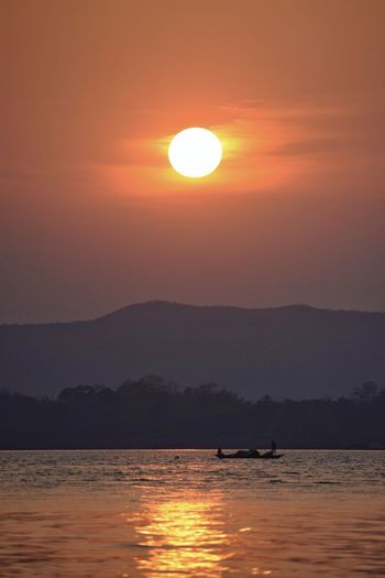 untold story of an evening Sunset_collection Red Sky Red Sunset Mountain And River Landscape_Collection Beautiful Evening Landscape Landscape_photography Best Of EyeEm Sky Water Sea Sunset Sun Beauty In Nature Nature Orange Color Sunlight Travel Silhouette Landscape