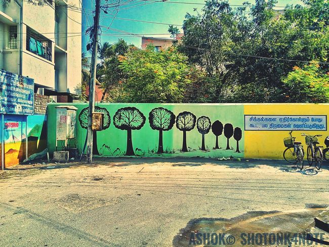 Street paint Chennai Lenovo Photography Nopeople Sun Sky TRENDING  Scenic Landscapes Streetphotography Streetarts Ashok 809 Nice Shot Fresh TRENDING  Lazyclick K4notephotography Nature Nature_collection Tree Road Day Outdoors No People Sunlight Architecture