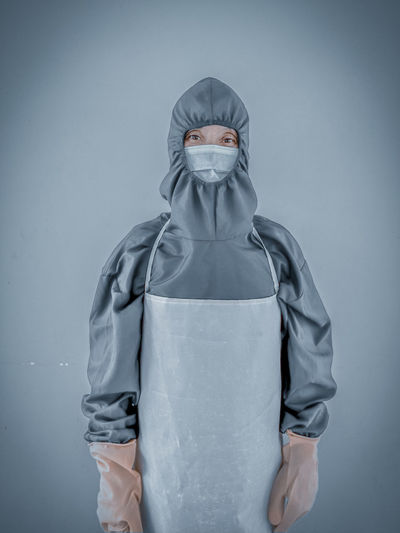 Woman wearing covid 19 ppe suit
