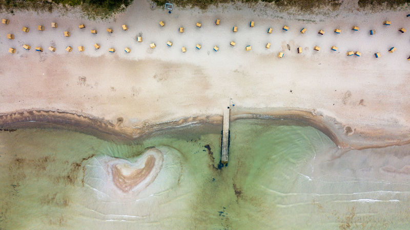 Pier at Baltic sea beach with lost person Baltic Sea Lost In The Landscape Ostsee Ostseeküste Ostseestrand Piercing Scharbeutz Beach Beach Chair Sand Waterfront World From Above Worldfromabove